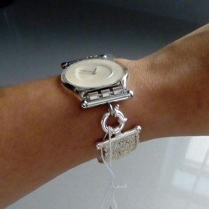Swatch ultra skin silvet watch